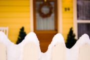 snow gently falling on Park City picket fence