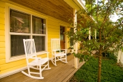 relax in rocking chairs on front porch during a Park City summer