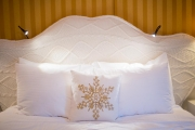 Gold Bedroom upholstered headboard with multiple reading lights.