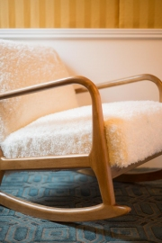 Get cozy with a book in the Gold Bedroom's rocking chair.